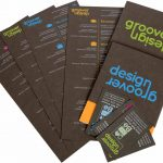 Photo of brochure and business cards of the Groover Design promo package, printed by Laser Image Printing & Marketing