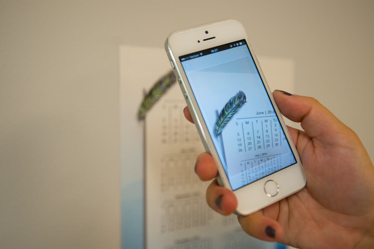 iPhone scanning a layAR trigger on a wall calendar
