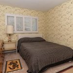 Photo of bedroom after wallpapering with HP WallArt